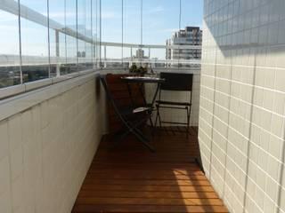 Cobertura Duplex: Terraços  por Palladino Arquitetura,