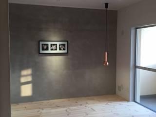 マンションリノベーション: 株式会社KIMURA  bi-Artが手掛けた寝室です。,