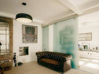 White Grounds Salas modernas de homify Moderno