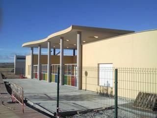 ALZADO SUR: Casas de estilo  de ESTUDIO DE ARQUITECTURA FEDERICO GALVAN