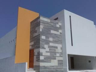 escala1.4 Casas de estilo moderno Caliza Amarillo