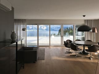 Modern Living Room by Egg and Dart Corporation GmbH & Co.KG | München Modern