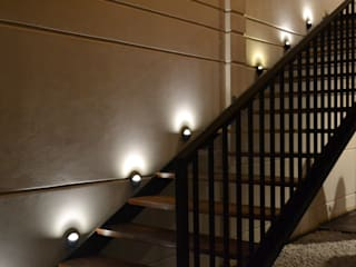 Pasillos y hall de entrada de estilo  por Entorno Arquitectura