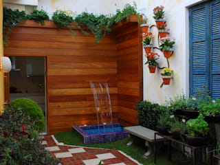 Eclectic style garden by Adriana Baccari Projetos de Interiores Eclectic