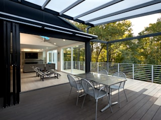 Cache House:  Patios & Decks by KUBE Architecture, Modern
