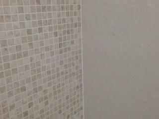 Acabamento impecável: Banheiros  por By CA