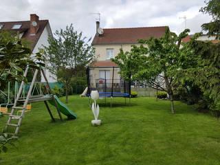 Maison et Jardin avant transformation:  de style  par Luxury Interiors