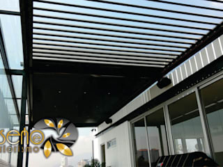 Pérgolas eléctricas:  de estilo  por Diseño e Interiorismo