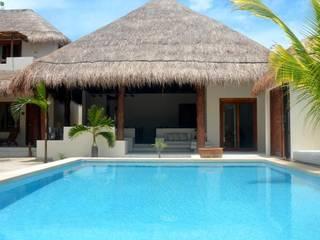 Boutique hotel Tierra del Mar - Holbox Hoteles de estilo tropical de sandro bortot arquitecto Tropical