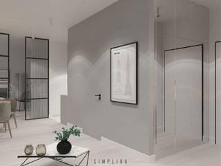Pasillos y vestíbulos de estilo  por SIMPLIKA