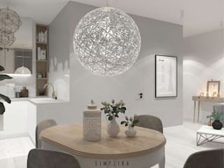 Scandinavian style dining room by SIMPLIKA Scandinavian