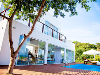 Fachada principal: Casas  por Aroeira Arquitetura