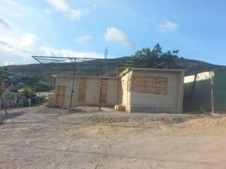 Casa Plaza (Vivienda Barrial Productiva): Casas de estilo  por Taller de Desarrollo Urbano