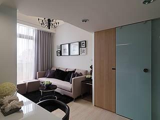 Living room by 大集國際室內裝修設計工程有限公司