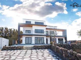 Casas modernas por 꿈애하우징