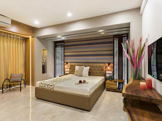Apartment in the Western Suburban of Mumbai The design house Modern style bedroom Wood Amber/Gold