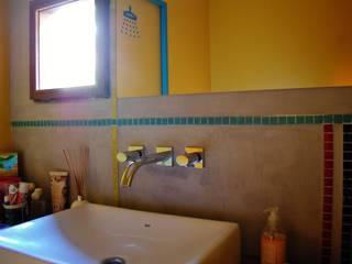 Baños de estilo  por Guadalupe Larrain arquitecta
