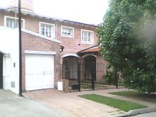 Dúplex en barrio Tres Cerritos: Casas de estilo  por Valy,Clásico