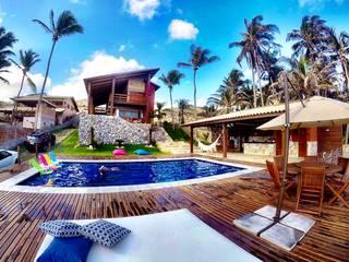 Residência de Praia Casas tropicais por DC PROJETOS Tropical