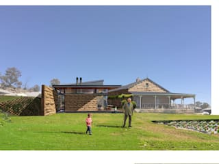Proposal for a renovation and new retirement unit, Bethlehem, Free State, South Africa. Building process: old sandstone house completed July 2017 and new unit (left on photo) almost finish. by Smit Architects