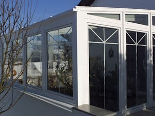 Wintergarten als Pflanzenoase Schmidinger Wintergärten, Fenster & Verglasungen Klassischer Wintergarten Glas