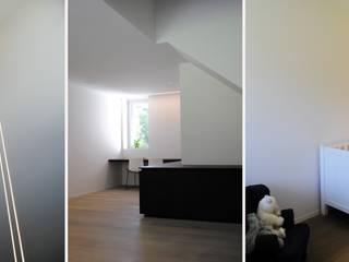 Project JI: moderne Woonkamer door ARD Architecten