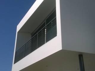 CASA GRILLO Casas minimalistas de ARQUITECTO MAURICIO PIZOLATTO Minimalista