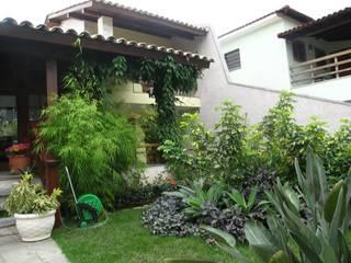 Residencia Recreio: Jardins  por Maria Dulce arquitetura,Moderno