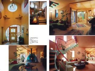 リビング&吹き抜け階段: スタジオドディチが手掛けたリビングです。