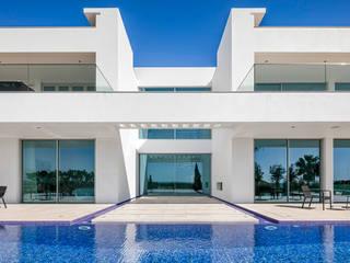 Casas modernas: Ideas, diseños y decoración de Hi-cam Portugal Moderno