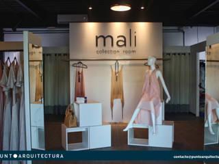 MALI COLECTION ROOM Espacios comerciales de estilo industrial de puntoarquitectura Industrial