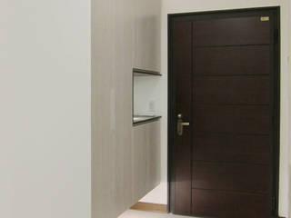 玄關:  走廊 & 玄關 by 以恩設計