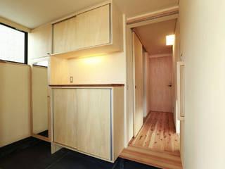 大森西の家: 光風舎1級建築士事務所が手掛けた廊下 & 玄関です。