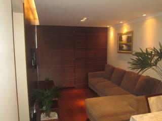 Reforma de Apartamento no Jardim Marajoara: Salas de estar  por Cambury Urbanismo e Arquitetura