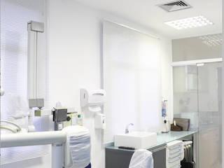 Clínica odontológica: Clínicas  por D2C Arquitetura,Moderno