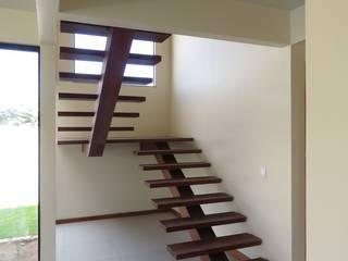 Aroeira Arquitetura Tropical corridor, hallway & stairs