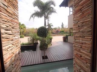 Jardines de estilo moderno de Principia Design Moderno