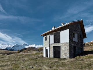 Casa FD storia di una casa non ancora finita Case moderne di es-arch Moderno