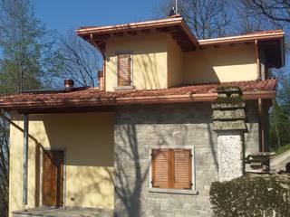 Casa in legno: Casa di legno in stile  di Marlegno