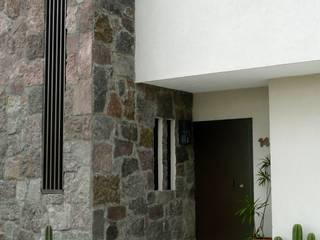 Alberto M. Saavedra Eclectic style houses Stone Beige