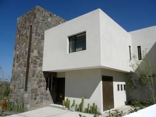 Alberto M. Saavedra Eclectic style houses