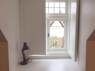 Solid panel shutters for study room windows:  Study/office by Plantation Shutters Ltd