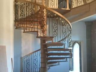 Oak and wrought iron spiral staircase :  Corridor & hallway by Boss Stairs