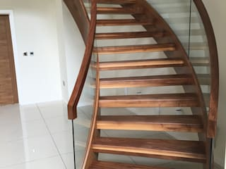 Walnut helical staircase :  Corridor & hallway by Boss Stairs