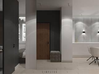 Pasillos, vestíbulos y escaleras de estilo minimalista de SIMPLIKA Minimalista