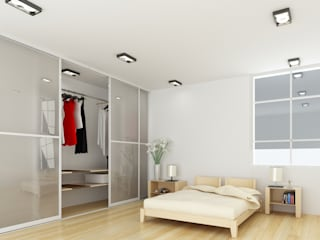 Sliding Door Wardrobes, Fitted Bedroom wardrobes, Hinged Wardrobes, Walk In Closets モダンスタイルの寝室 の Bravo London Ltd モダン