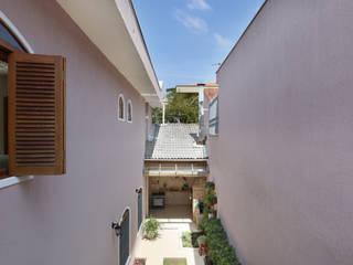 Casa Planalto Paulista - SP: Jardins  por Antonio Armando Arquitetura & Design