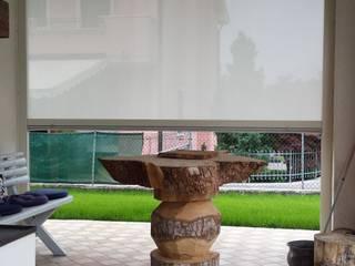 Come vivere un portico tutto l'anno Case moderne di VIP TENDE Moderno