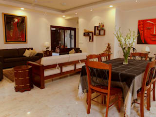 An apartment in Central Park 1, Gurgaon:  Dining room by stonehenge designs