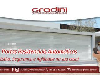 Portas de enrolar automaticas: Garagens e edículas  por Gradini Portas de enrolar automáticas,